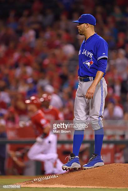 Pitcher David Price of the Toronto Blue Jays reacts after allowing a solo home run to Kole Calhoun of the Los Angeles Angels of Anaheim during the...