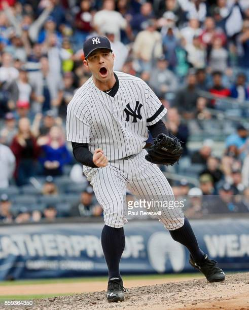 Pitcher David Robertson of the New York Yankees reacts to striking out Justin Smoak to end the 8th inning with runners on base in an MLB baseball...