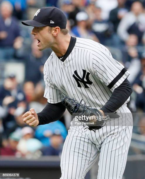 Pitcher David Robertson of the New York Yankees runs off the field after striking out Justin Smoak to end the 8th inning with runners on base in an...