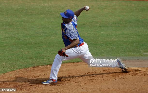 TOPSHOT Pitcher David Santamaria of Colombia throws during the third inning of the men's final baseball game against Panama at the XVIII Bolivarian...