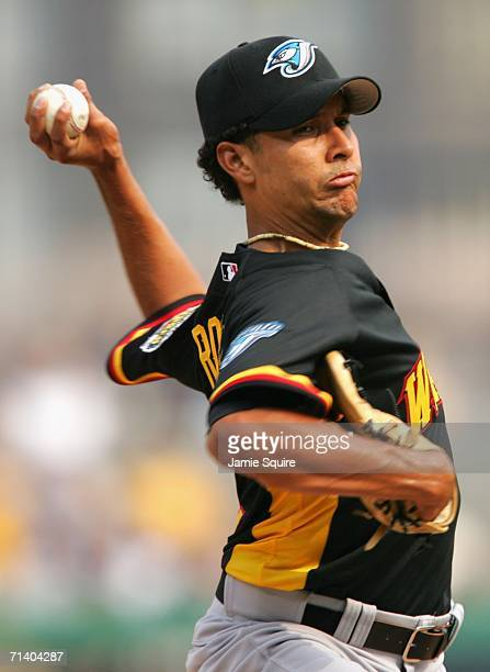 Pitcher Davis Romero of the World Team pitches against the U.S.A. Team during the XM Satellite Radio All-Star Futures Game at PNC Park on July 9,...