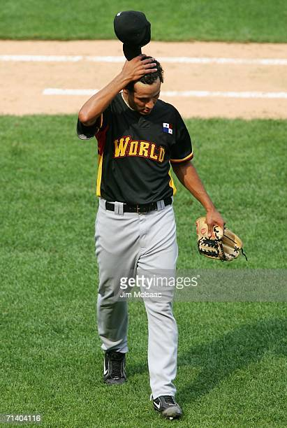 Pitcher Davis Romero of the World Team walks off the field against the U.S.A. Team during the XM Satellite Radio All-Star Futures Game at PNC Park on...