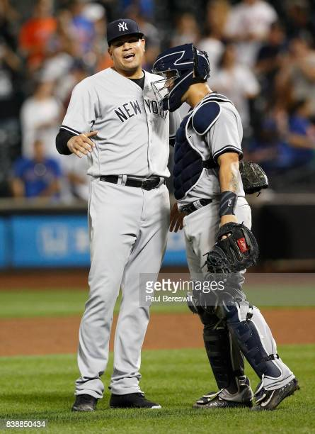 Pitcher Dellin Betances celebrates with catcher Gary Sanchez of the New York Yankees after an interleague MLB baseball game against the New York Mets...