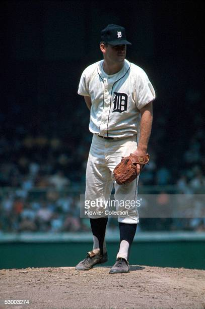 Pitcher Denny McLain of the Detroit Tigers, takes the sign for the next pitchh during a game in 1968 at Tiger Stadium in Detroit, Michigan.
