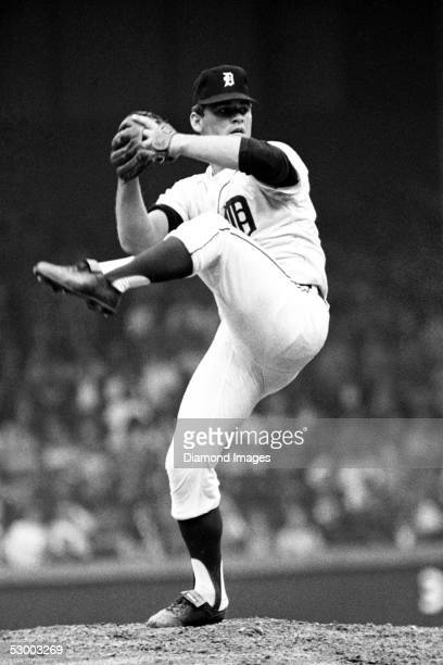Pitcher Denny McLain of the Detroit Tigers winds up to deliver a pitch during a game in 1968 at Tiger Stadium in Detroit, Michigan.