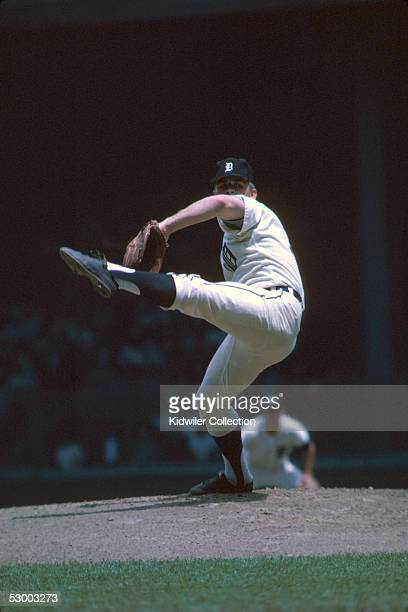 Pitcher Denny McLain of the Detroit Tigers winds up to deliver a pitch during a game in 1968 at Tiger Stadium in Detroit Michigan