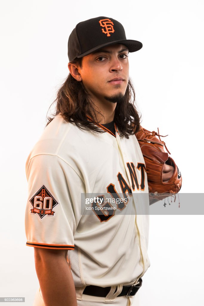 Pitcher Dereck Rodriguez (83) poses for a photo during the San Francisco Giants photo day on Tuesday, Feb. 20, 2018 at Scottsdale Stadium in Scottsdale, Ariz.