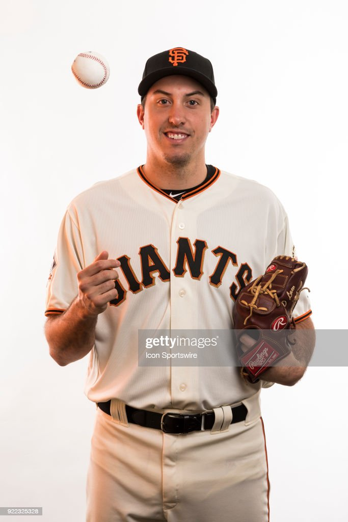 Pitcher Derek Law (64) poses for a photo during the San Francisco Giants photo day on Tuesday, Feb. 20, 2018 at Scottsdale Stadium in Scottsdale, Ariz.