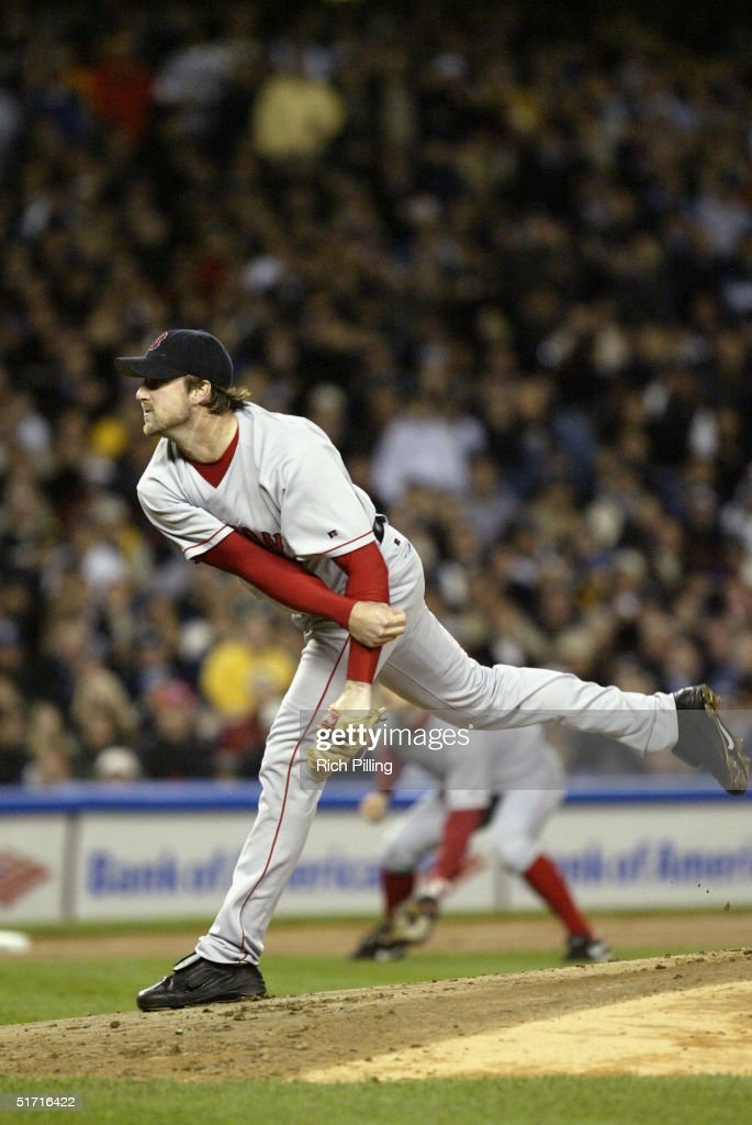 Pitcher Derek Lowe of the Boston Red Sox pitches during game seven of the ALCS against the New York Yankees at Yankee Stadium on October 20, 2004 in the Bronx, New York. The Red Sox defeated the Yankees 10-3 to win the series four games to three.