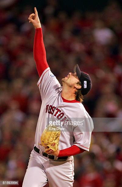 Pitcher Derek Lowe of the Boston Red Sox points to a popup out hit by Albert Pujols of the St Louis Cardinals in the sixth inning during game four of...