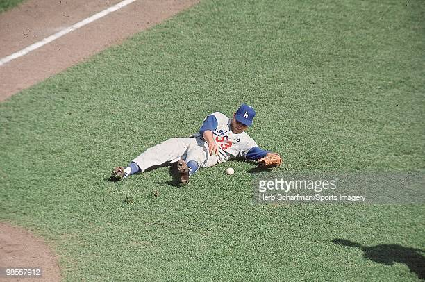 Pitcher Don Drysdale of the Los Angeles Dodgers tries to field a ball during the 1965 World Series against the Minnesota Twins on October 6 1965 at...