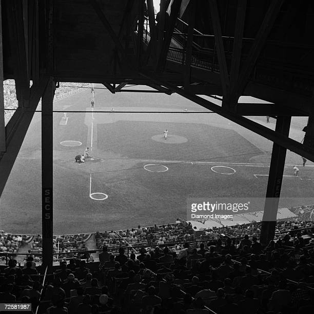 Pitcher Don Larsen of the New York Yankees follows through on a pitch to Gil Hodges of the Brooklyn Dodgers during game 2 of the World Series on...