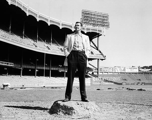 Pitcher Don Larsen of the New York Yankees poses for a portrait on the remnants of the pitching mound on October 11 1956 at Yankee Stadium in New...