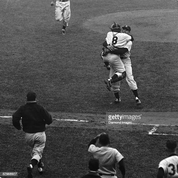 Pitcher Don Larsen of the New York Yankees wraps his arms around catcher Yogi Berra after the final pitch of Game 5 of the 1956 World Series against...