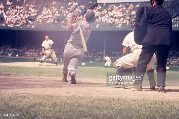 Pitcher Don Mossi of the Detroit Tigers looks up for the ball after Walt Dropo of the Baltimore Orioles popped it up during an MLB game on June 28...