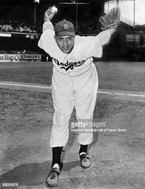 Pitcher Don Newcombe of the Brooklyn Dodgers poses for an action portrait in a windup stance before a game Don Newcombe played for the Dodgers from...