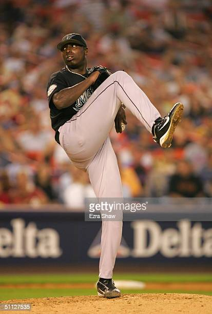 Pitcher Dontrelle Willis of the Florida Marlins delivers a pitch during the game against the New York Mets at Shea Stadium on July 19 2004 in...