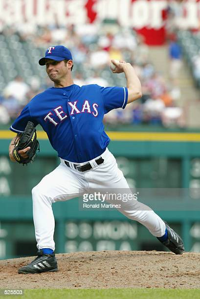Pitcher Doug Davis of the Texas Rangers throws a pitch during the MLB game against the Oakland Athletics at The Ballpark in Arlington Texas on April...