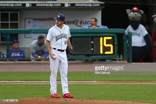 Pitcher Drew Anderson of the Lehigh Valley Iron Pigs gets set to pitch as a pitch clock counts down during the second inning of a AAA minor league...