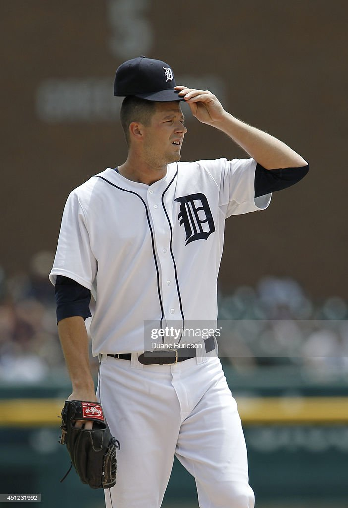 df933b088d Pitcher Drew Smyly of the Detroit Tigers adjusts his cap while ...