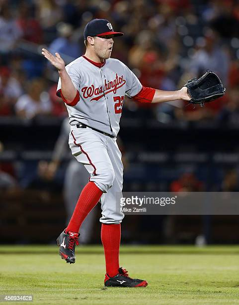 Pitcher Drew Storen of the Washington Nationals celebrates the divisionclinching game against the Atlanta Braves at Turner Field on September 16 2014...