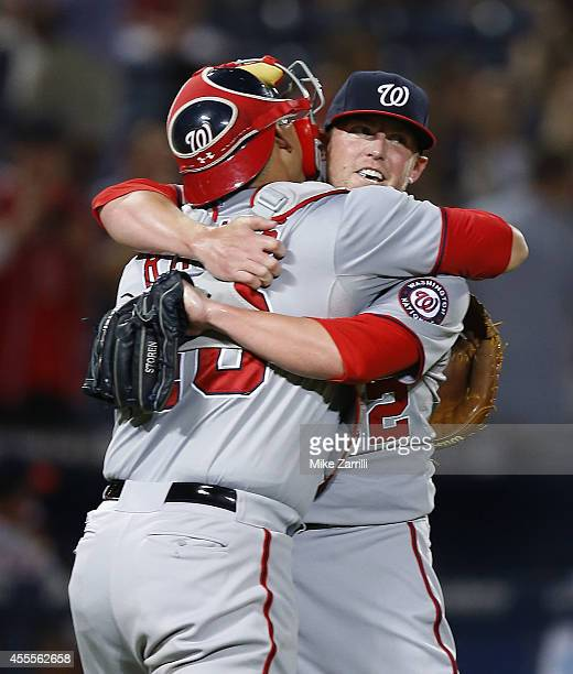 Pitcher Drew Storen of the Washington Nationals celebrates with catcher Wilson Ramos after the divisionclinching game against the Atlanta Braves at...