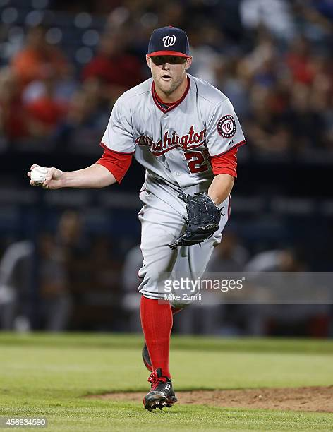 Pitcher Drew Storen of the Washington Nationals makes a play on a ground ball during the game against the Atlanta Braves at Turner Field on September...