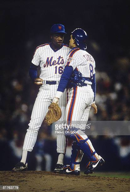 Pitcher Dwight Gooden and catcher Gary Carter of the New York Mets talk on the mound during the World Series against the Boston Red Sox at Shea...