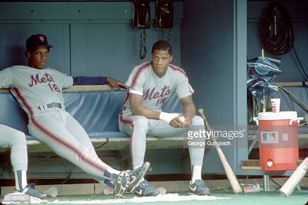 Pitcher Dwight Gooden and outfielder Darryl Strawberry of the New York Mets in the dugout during a game against the Pittsburgh Pirates at Three...