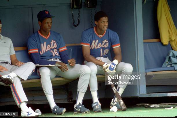 Pitcher Dwight Gooden and outfielder Darryl Strawberry of the New York Mets sit in the dugout during a game against the Pittsburgh Pirates at Three...