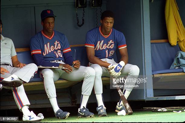 Pitcher Dwight Gooden and outfielder Darryl Strawberry of the New York Mets look on from the dugout during a game against the Pittsburgh Pirates at...