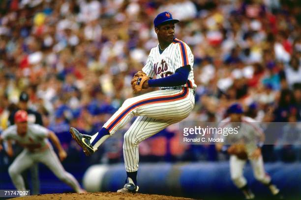 Pitcher Dwight Gooden of the New York Mets pitches to the St Louis Cardinals at Shea Stadium during a season game ion September 12 l987 in Flushing...