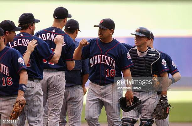 Pitcher Eddie Guardado of the Minnesota Twins high signs during lineup introductions prior to the interleague game against the Milwaukee Brewers on...