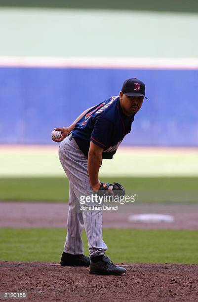 Pitcher Eddie Guardado of the Minnesota Twins looks for the signal during the interleague game against the Milwaukee Brewers on June 22 2003 at...