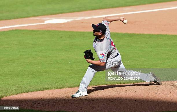 Pitcher Edgar Garcia of Tigres del Licey of the Dominican Republic throws against Criollos de Caguas of Puerto Rico during the Caribbean Baseball...
