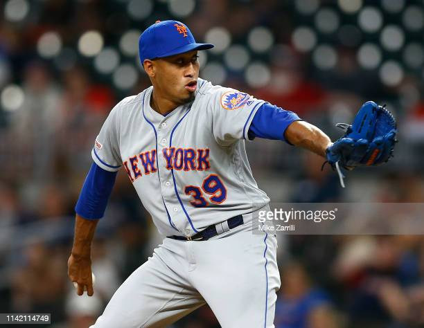 Pitcher Edwin Diaz of the New York Mets throws a pitch in the ninth inning during the game against the Atlanta Braves at SunTrust Park on April 11,...
