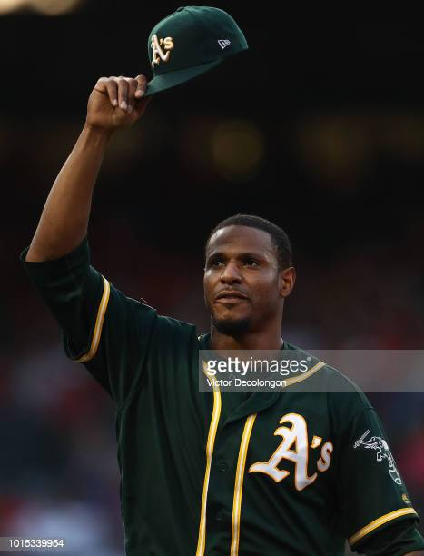 Pitcher Edwin Jackson of the Oakland Athletics tips his hat to teammate Ramon Laureano after Laureano's catch for the first out at center field and...