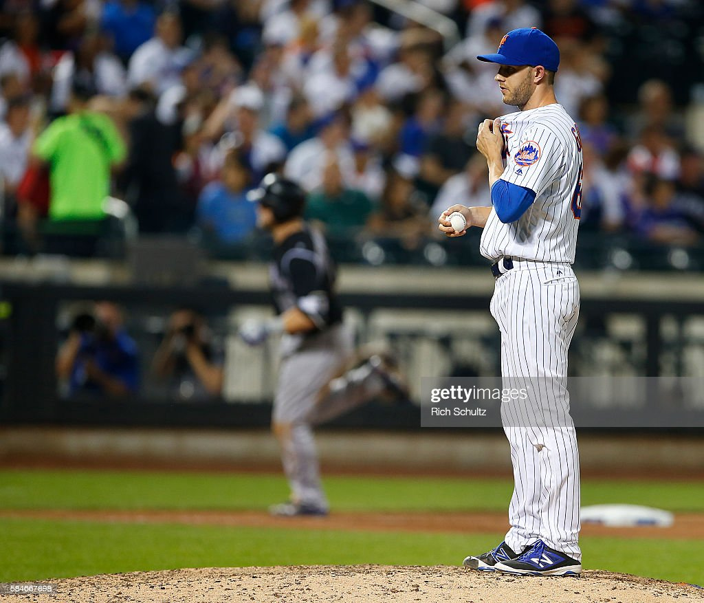 Pitcher Erik Goeddel #62 of the New York Mets looks to home plate as Mark Reynolds #12 of the Colorado Rockies rounds third base after hitting a home run in the eighth inning of a game at Citi Field on July 29, 2016 in the Flushing neighborhood of the Queens borough of New York City.