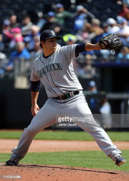 Pitcher Erik Swanson of the Seattle Mariners pitches in his Major League debut during the game against the Kansas City Royals at Kauffman Stadium on...