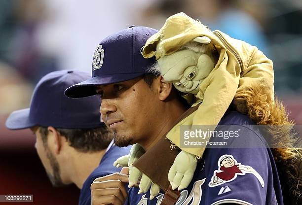 Pitcher Ernesto Frieri of the San Diego Padres wears a Yoda doll on his back while in the dugout before the Major League Baseball game against the...