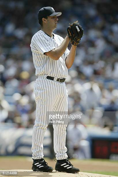 Pitcher Esteban Loaiza of the New York Yankees prepares to pitch during the game against the Toronto Blue Jays at Yankee Stadium on August 9 2004 in...
