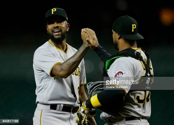 Pitcher Felipe Rivero of the Pittsburgh Pirates celebrates with catcher Elias Diaz of the Pittsburgh Pirates while talking with Miguel Cabrera of the...