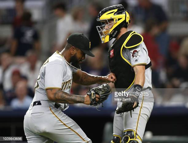 Pitcher Felipe Vazquez of the Pittsburgh Pirates punches catcher Francisco Cervelli in celebration after the game against the Atlanta Braves at...