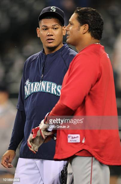 Pitcher Felix Hernandez of the Seattle Mariners talks with Bobby Abreu of the Los Angeles Angels of Anaheim during batting practice prior to their...