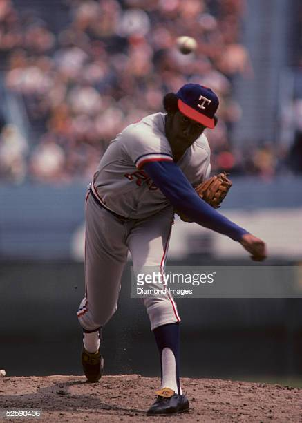 Pitcher Fergie Jenkins of the Texas Rangers follows through on a pitch during a game on August 18 1974 against the Cleveland Indians at Municipal...