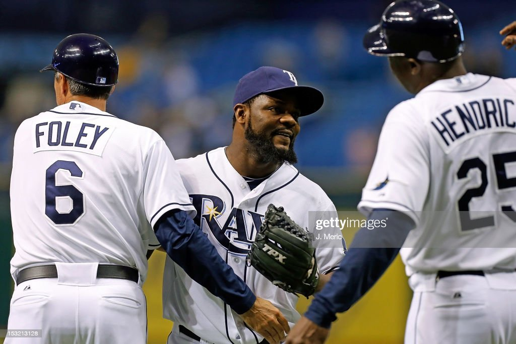 Pitcher Fernando Rodney #56 of the Tampa Bay Rays is congratulated by coaches Tom Foley #6 and George Hendrick #25 after his save against the Baltimore Orioles at Tropicana Field on October 1, 2012 in St. Petersburg, Florida.