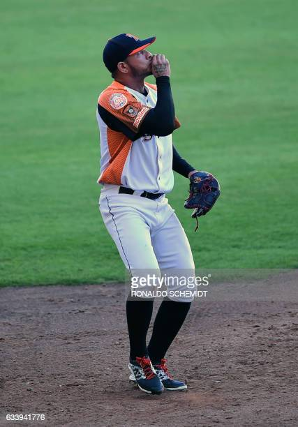 Pitcher Francisco Butto of Aguilas del Zulia of Venezuela celebrates after winning their Caribbean Baseball Series match against Tigres del Licey of...