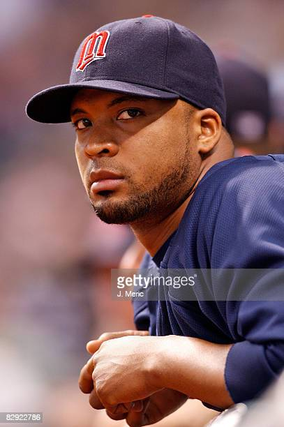 Pitcher Francisco Liriano of the Minnesota Twins watches his team from the dugout against the Tampa Bay Rays during the game on September 19 2008 at...