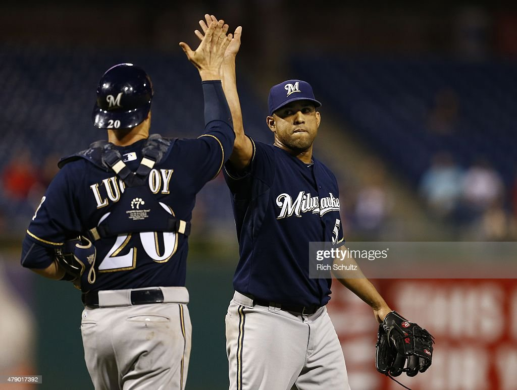 Pitcher Francisco Rodriguez #57 of the Milwaukee Brewers is congratulated by catcher Jonathan Lucroy #20 after getting the save and defeating the Philadelphia Phillies 7-4 during a MLB game at Citizens Bank Park on June 29, 2015 in Philadelphia, Pennsylvania.