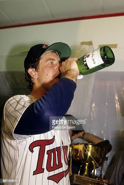 Pitcher Frank Viola of the Minnesota Twins drinking champagne holding the MVP trophy after the Twins defeated the St Louis Cardinals in game seven of...